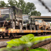 Army Trucks on A Train