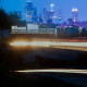 city skyline with traffic motion light trails
