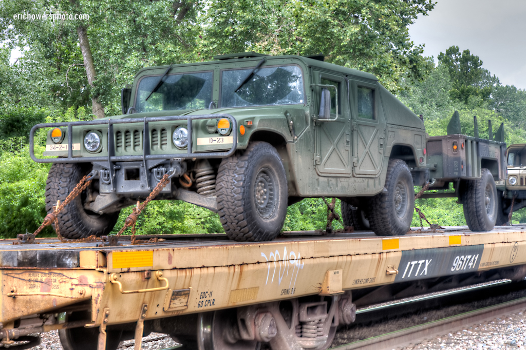 Army Trucks on A Train - Humvees