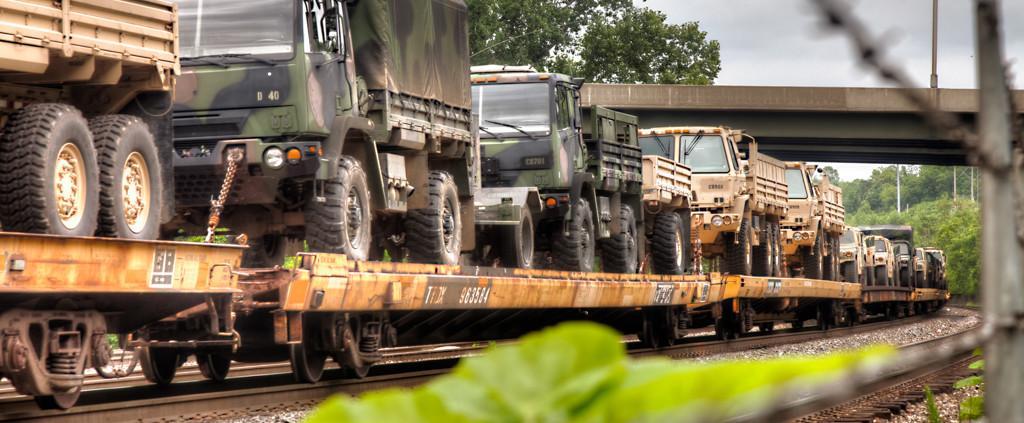 Army Trucks on A Train