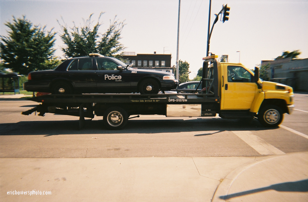 KCPD Police Patrol Car on Tow Truck